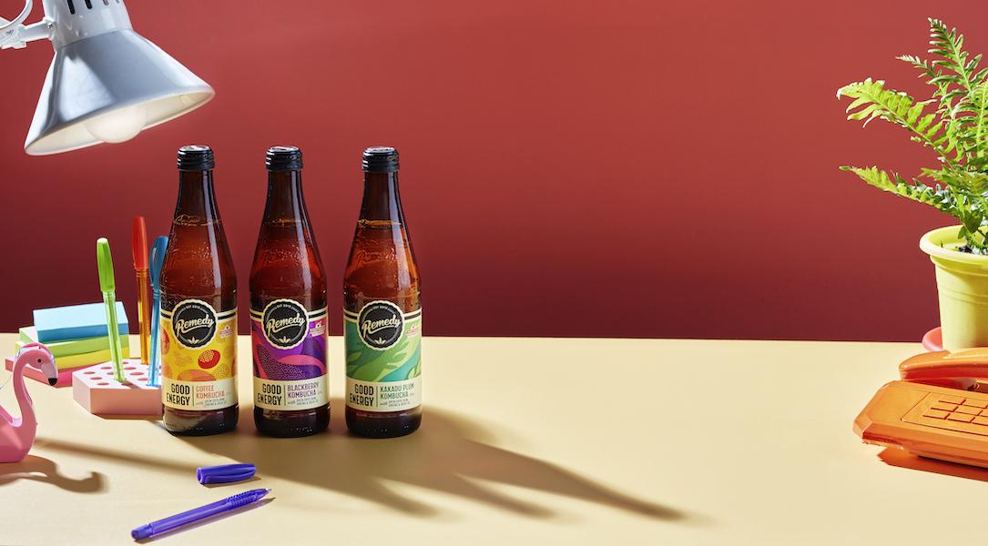 Three bottles of Remedy Good Energy on a desk