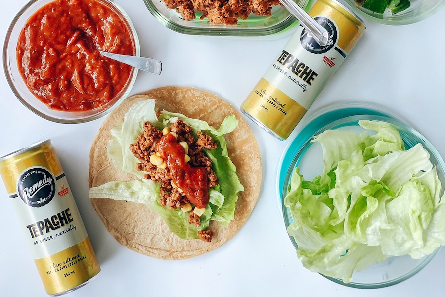 Tacos with cans of Remedy Tepache